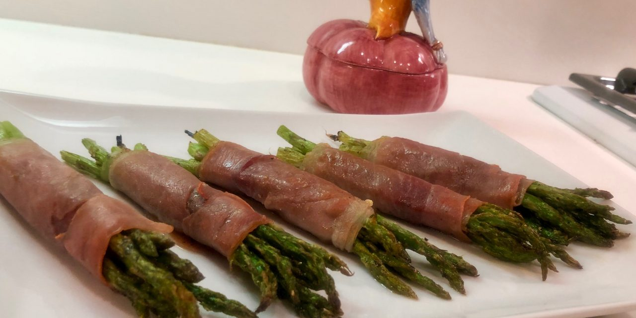 Slim Man Cooks Baked Asparagus Wrapped in Prosciutto